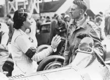Kay Petre in Brooklands paddock beside her car (Riley ?) JCC International Trophy Maybe 1938